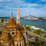 Budapest, Hungary - Aerial view of Reformed Church at Szilagyi Dezso Square with the Hungarian Parliament. And River Danube at background royalty free stock photo