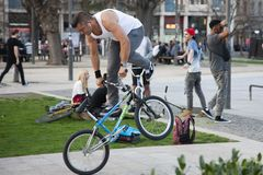 Budapest, Hungary - April 9, 2018: Extreme bicycle rider performing freestyle tricks on bike stock image