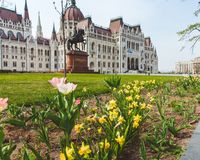BUDAPEST, HUNGARY - APRIL 03, 2019: Tourists walking near the Parliament Hungary ,Budapest royalty free stock photos