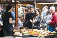 Budapest, Hungary - April 5, 2018: Young couple buying traditional street food stock photo