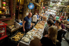 BUDAPEST, HUNGARY - AVRIL 17, 2016: Ruin Bar Szimplakert, Kazinc. BUDAPEST, HUNGARY - AVRIL 17, 2016: cheese and bread in the handicrafts market Szimpla - Ruin Royalty Free Stock Image