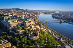 Budapest, Hungary - Beautiful aerial skyline view of Buda Castle Royal Palace and South Rondella at sunset. With Szechenyi Chain Bridge over River Danube stock photography