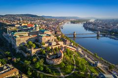 Budapest, Hungary - Beautiful aerial skyline view of Buda Castle Royal Palace and South Rondella at sunset. With Szechenyi Chain Bridge over River Danube royalty free stock photo