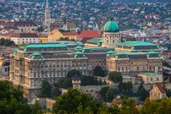Budapest, Hungary - The beautiful Buda Castle Royal Palace with the Buda hills and the Matthias Church. At background royalty free stock photography