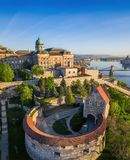 Budapest, Hungary - Beautiful Buda Castle Royal Palace and South Rondella with Szechenyi Chain Bridge. And Parliament at sunrise Royalty Free Stock Photo