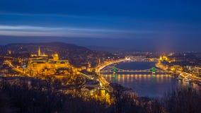 Budapest, Hungary - The beautiful illuminated Historic Royal Palace or Buda Castle with Szechenyi Chain Bridge. Parliament and Matthias Church and the Buda stock photo