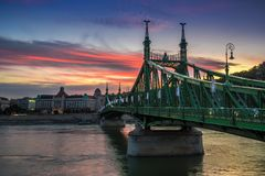Budapest, Hungary - The beautiful Liberty Bridge at sunset with amazing colorful sky Stock Image