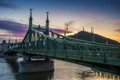Budapest, Hungary - The beautiful Liberty Bridge at suset with amazing colorful sky. And clouds royalty free stock image
