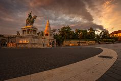 Budapest, Hungary - Beautiful morning lights at Fisherman`s Bastion and statue of Stephen I. with colorful sky. And clouds Stock Photos