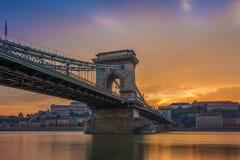 Budapest, Hungary - The beautiful Szechenyi Chain Bridge and Buda Castle Royal Palace. With amazing colorful sunset and sky stock photos