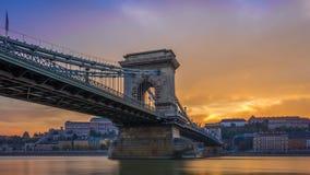 Budapest, Hungary - The beautiful Szechenyi Chain Bridge and Buda Castle Royal Palace. With amazing colorful sunset and sky royalty free stock photos