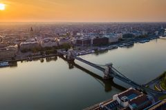 Budapest, Hungary - Beautiful Szechenyi Chain Bridge over River Danube at sunrise with St. Stephen`s Basilica. And skyline of Pest side of Budapest stock images