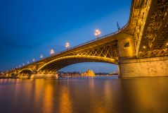 Budapest, Hungary - Blue hour at the beautiful illuminated Margaret Bridge with the Parliament of Hungary royalty free stock photo