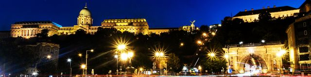 Car traffic trail lights with illuminated Chain bridge and Buda Castle in Budapest, Hungary at night. Budapest, Hungary. Car traffic trail lights with stock photos
