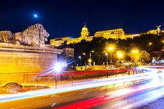 Illuminated Chain bridge and Buda Castle in Budapest, Hungary at night Royalty Free Stock Images