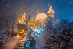 Budapest, Hungary - Christmas market in snowy City Park Varosliget from above at night with snowy trees stock photography