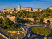 Budapest, Hungary - Clark Adam square roundabout from above at sunrise with Buda Castle Royal Palace. And Tunnel and traditional yellow tram royalty free stock photos