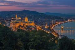 Budapest, Hungary - Colorful sunset at magic hour over Budapest with Buda Castle Royal Palace. And famous Szechenyi Chain Bridge stock photo