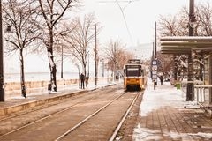 BUDAPEST, HUNGARY - 16 DECEMBER, 2018: Danube embankment with yellow tram from Buda side in winter in Budapest, Hungary stock photos