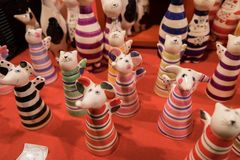 Funny ceramic cats and mouses figurines for sale. BUDAPEST, HUNGARY - DECEMBER 7, 2016: funny ceramic cats and mouses figurines for sale at christmas market stock images
