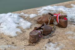 Shoes on the Danube shore, Budapest, Hungary royalty free stock photography