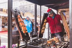 BUDAPEST, HUNGARY - DECEMBER 19, 2018: Tourists and local people enjoying the beautiful Christmas Market at St. Stephen's Square royalty free stock photos