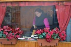 BUDAPEST, HUNGARY - DECEMBER 29, 2017: Woman cooking National Hungarian BBQ baking -Kurtosh Kalach in Budapest on December 29, 20. 17 stock image