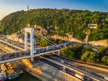 Budapest, Hungary - Elisabeth bridge Erzsebet hid early in the morning on an aerial shot with Gellert Hill. And Gellert memorial, Statue of Liberty and heavy royalty free stock image