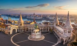 Budapest, Hungary - The famous Fisherman`s Bastion at sunrise with statue of King Stephen I and Parliament. Of Hungary at background stock images