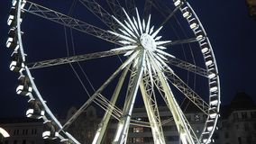Budapest, Hungary. The Ferris wheel illuminated in white in the evening. It is located in the city center