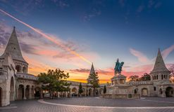 Budapest, Hungary - Fisherman`s Bastion Halaszbastya and statue of King Stephen I. With colorful sky and clouds at sunrise stock images