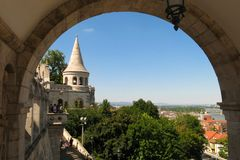 Budapest Hungary Fisherman's Bastion view through arch. The stone archways of Fishermen's Bastion frame picturesque views of Budapest, Hungary Royalty Free Stock Photos