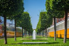 Budapest, Hungary - Fountains at the center of Budapest with iconic yellow trams on the move. On a bright summer day Royalty Free Stock Photos