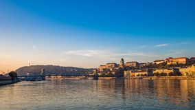 Budapest, Hungary - Golden sunrise over the River Danube with Szechenyi Chain Bridge, Buda Castle Royal Palace. Gellert Hill and Statue of Liberty at stock images