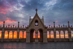Budapest, Hungary - The Hungarian Parliament through the Fisherman`s Bastion`s arch windows. At sunrise with beautiful sky and clouds Stock Photography
