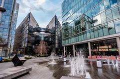 Fontain near City Hall and modern glass buildings in London, UK Royalty Free Stock Photos