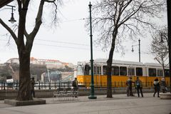 BUDAPEST, HUNGARY - JANUARY 2018: Yellow tram on the promenade of Budapest, Hungary on January 18, 2018. Budapest is the capital royalty free stock photography