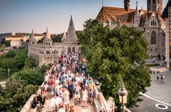 People on terrace and Mathias Church in Fishermen Bastion Stock Photos