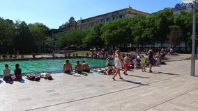 Budapest, Hungary - July 13th, 2017: Young people gathering in a park in Budapest Hungary . stock video