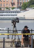 Budapest, Hungary – June 11, 2019; Cameraman with camera waiting for the the raising action of the sunken Hableany tour ship. In Danube royalty free stock image
