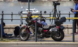 Budapest, Hungary – June 11, 2019; Cameramen with camera next to a motorbike waiting for the the raising action of the sunken. Hableany tour ship in royalty free stock photos