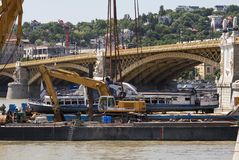 Budapest, Hungary – June 11, 2019; The end of the successfully raising action to the surface of the sunken Hableany tour ship. Lies on the barge royalty free stock image