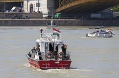 Budapest, Hungary – June 11, 2019; Fireboat assure the area of the raising action of the sunken Hableany tour ship. In Danube next to Margaret Bridge stock photo
