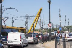 Budapest, Hungary – June 11, 2019; Image of the Clark Adam ship crane arm. And traffic jam on Margaret bridge. Sunken Hableany tour ship raising action stock image