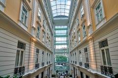 BUDAPEST, HUNGARY - JUNE 3, 2017: Interior grand atrium inside C. Orinthia Hotel Budapest, known as `Grand Hotel Budapest` or `Grand Hotel Royal`.  Atrium has Stock Image