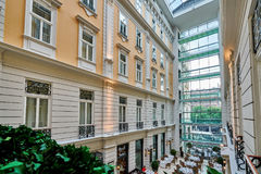BUDAPEST, HUNGARY - JUNE 3, 2017: Interior grand atrium inside C. Orinthia Hotel Budapest, known as `Grand Hotel Budapest` or `Grand Hotel Royal`.  Atrium has a Royalty Free Stock Photography