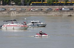 Budapest, Hungary – June 11, 2019; Police and rescue boat assure the area of the raising action of the sunken Hableany tour ship. In Danube royalty free stock photo