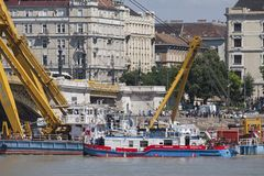Budapest, Hungary – June 11, 2019; Pusher craft Botond next to Clark Adam ship crane. After the raising action to the surface of the sunken Hableany tour royalty free stock photo