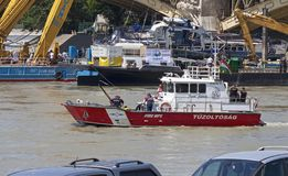 Budapest, Hungary – June 11, 2019; Raising action to the surface of the sunken Hableany tour ship. With fireboat royalty free stock photo