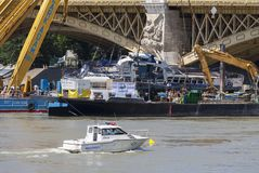 Budapest, Hungary – June 11, 2019; Raising action to the surface of the sunken Hableany tour. Ship with police ship royalty free stock images